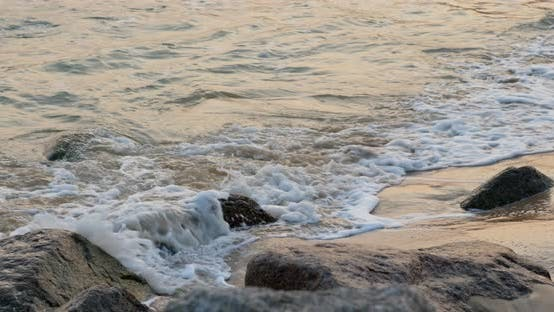 Thumbnail for Water wave on sandy beach in the evening