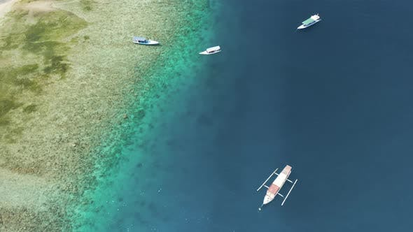 Thumbnail for Aerial view of small boats and snorkellers on a coral reef