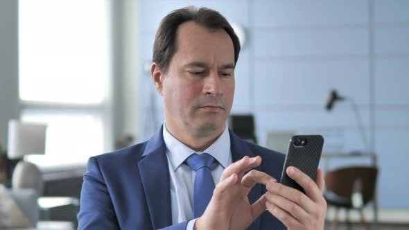 Thumbnail for Businessman Using Smartphone, Typing Message