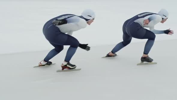 Thumbnail for Female Teammates Practicing for Speed Skating Race