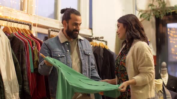 Thumbnail for Couple Choosing Clothes at Vintage Clothing Store