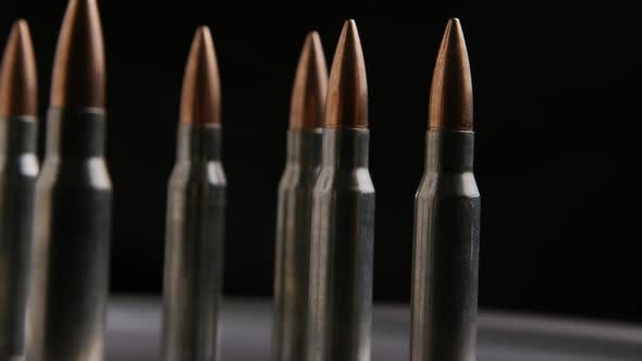 Thumbnail for Cinematic rotating shot of bullets on a metallic surface - BULLETS 014