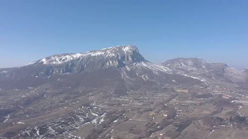 Winter scenery with Stol mountain 4K drone footage