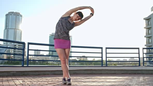 Thumbnail for Female Athlete Warming Up before Run