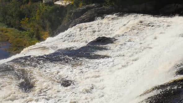 Thumbnail for Revealing a Large Amount of Water Rushing Over A Big Waterfall in Quebec 2