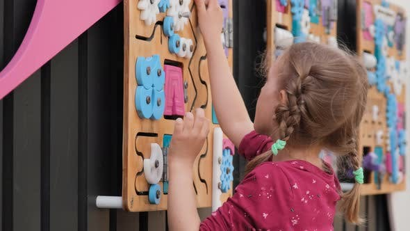 Cute Little Girl Playing Puzzle Game Outdoors