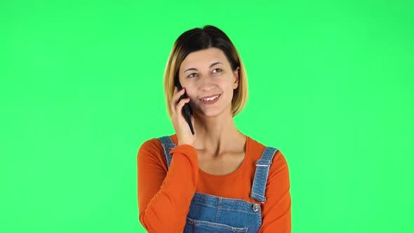 Cover Image for Smiling Girl Talking for Mobile Phone. Green Screen