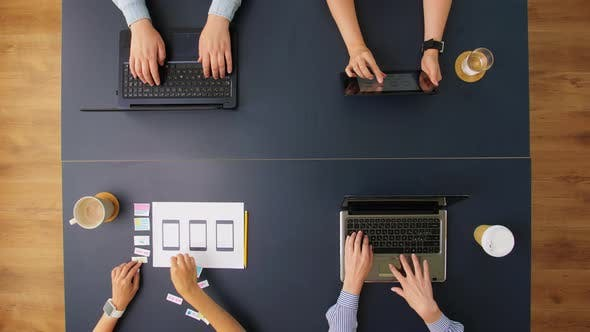 Thumbnail for Business Team with Gadgets Working at Office Table