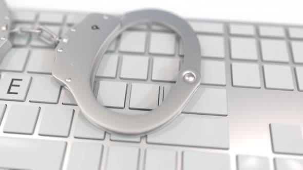 Thumbnail for Handcuffs on Keyboard with CRIME Word
