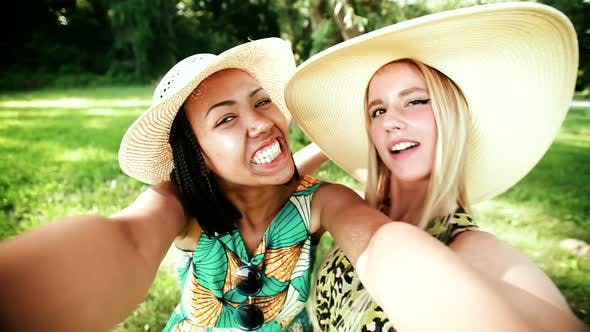 Thumbnail for Two young women having fun while taking a selfie