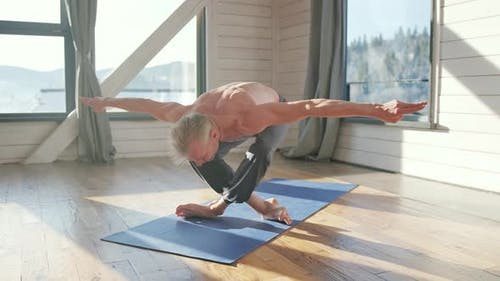 Athletic and Handsome Mature Man Practicing Yoga Asana