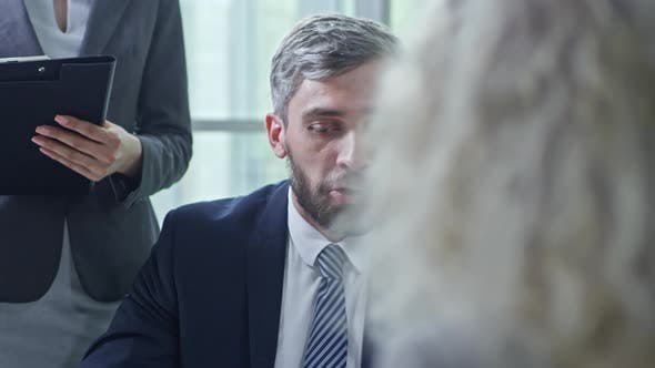 Thumbnail for Businessman Talking to Unrecognizable Businesswoman