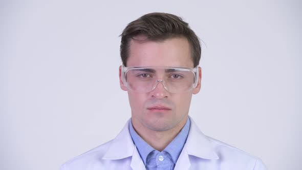 Thumbnail for Young Happy Handsome Man Doctor Wearing Protective Glasses