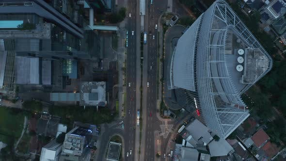 Thumbnail for Aerial Birds Eye Overhead Top Down View of Busy City Traffic and Public Transportation on a Busy