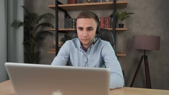 Thumbnail for Young Call Center Agent in Headset Consult Business Client Online Using Laptop. Businessman in
