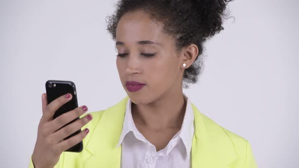 Thumbnail for Face of Young Happy African Businesswoman Using Phone