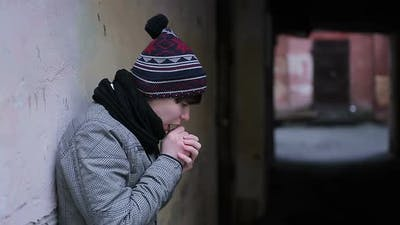Depressed Guy Suffering From Cold and Loneliness in Strange Abandoned Place