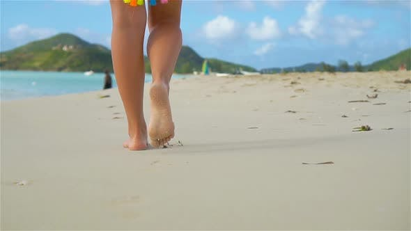 Thumbnail for Close Up Female Feet Walking Barefoot on Sea Shore