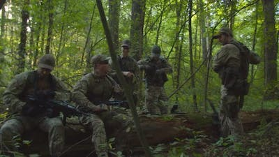 Antiterrorism Unit Getting Ready to Military Operation in Forest
