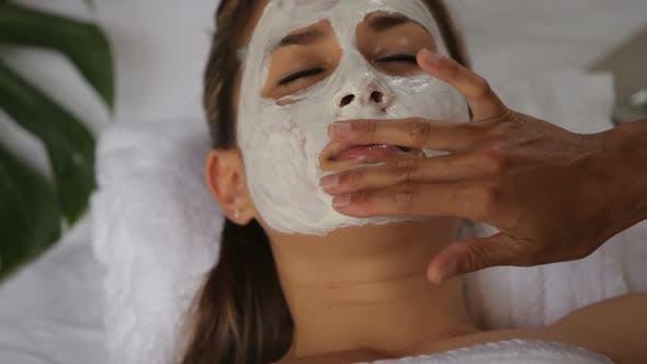 Thumbnail for Woman at spa getting facial treatment