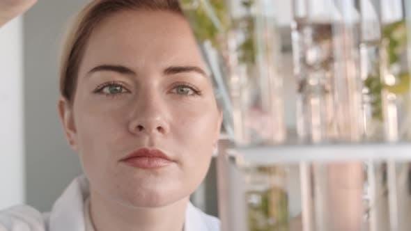 Thumbnail for Female Biologist Checking on Test Tubes