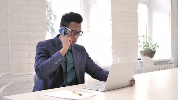 Thumbnail for Businessman Talking on Phone, Negotiating with Customer
