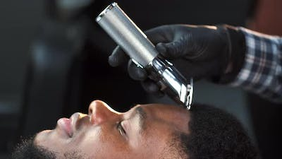 Male Barber Shaving Client Haircut in Barbershop