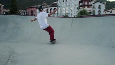 Skateboarding in Special Park Sportsman is Riding Skateboard in City Park