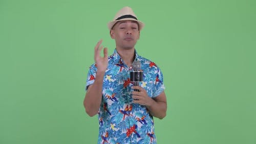 Happy Multi Ethnic Tourist Man As Host with Microphone