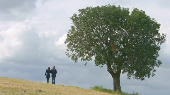 Thumbnail for Husband and Wife Walking in Field Hand in Hand, Married Couple Together Forever