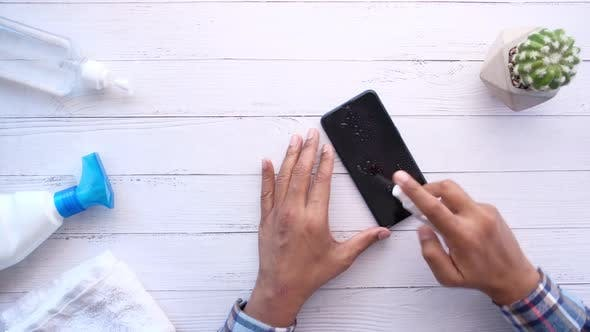 Thumbnail for Man Wipe Smart Phone Surface with Antibacterial Liquid for Preventing Virus