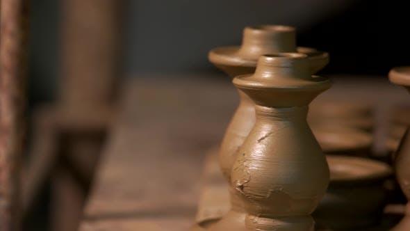 Handmade Ceramic Vases on Shelf in Pottery Workshop