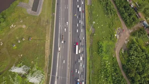 Thumbnail for Aerial Vertical Shot. Cars Driving By the Road. Moving Camera To the Bridge
