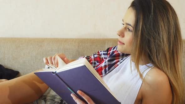 Thumbnail for The Young Girl Is Reading a Book