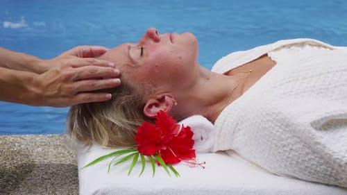 Woman at spa gets head massage. Shot on RED EPIC for high quality 4K, UHD, Ultra HD resolution.