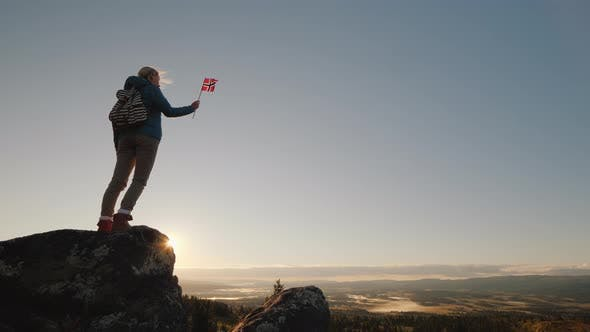 Thumbnail for Traveler with the Flag of Norway on Top of a Mountain with a Beautiful Panorama of the Nature of