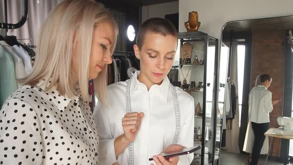 Woman Fashion Designer Discuss with Buyer