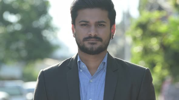 Thumbnail for Young Happy Bearded Indian Businessman in Suit Smiling Outdoors