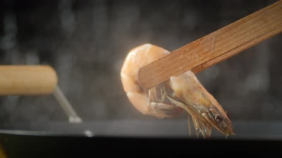 Thumbnail for Wooden Tongs with Boiled Shrimp.