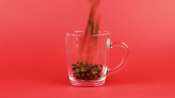 Thumbnail for Coffee Bean Quickly Pour, Transparent Glass Cup, Red Background. Morning Concept