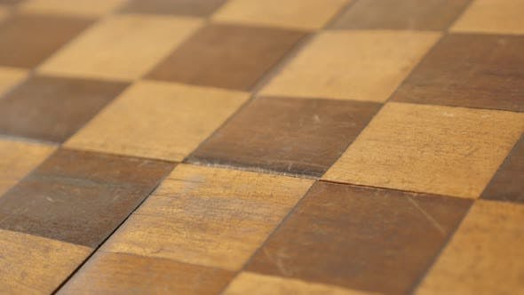 Close-up of wooden board game patina and traces of use  4K 2160p 30fps UltraHD tilting footage - Anc