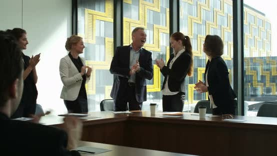 Thumbnail for Business group clapping and smiling