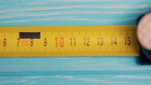 Roll of Measuring Tape in Motion Macro