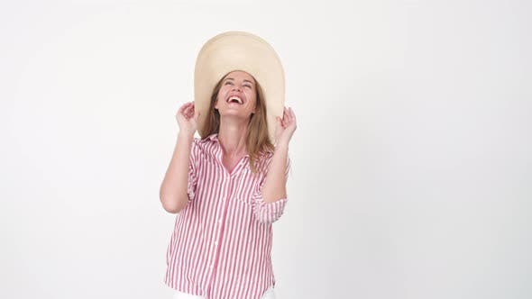 Thumbnail for Woman Catching and Putting on Hat