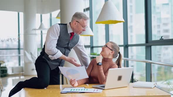 Thumbnail for Mature entrepreneur and secretary in the modern company