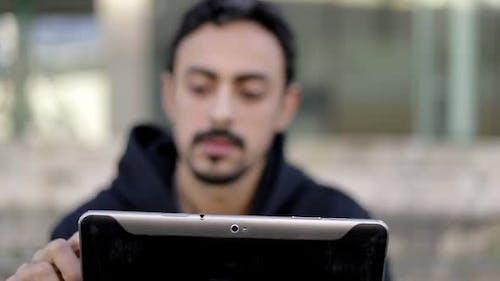Selective Focus of Man Using Digital Tablet