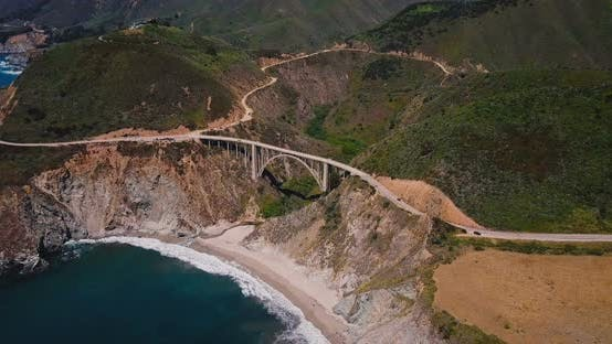 Thumbnail for Drone Zooming in on Incredible Bixby Canyon Bridge and Highway 1 Epic Summer Landscape Panorama