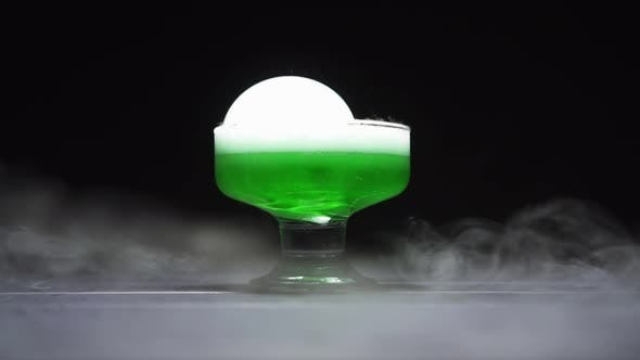 Thumbnail for Magic Potion Is Brewed in a Glass Bowl on a Black Background.