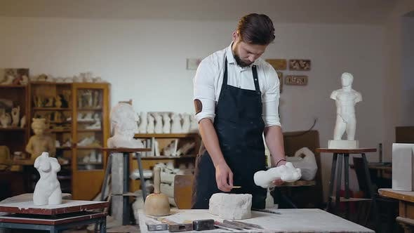 Thumbnail for Bearded Male Master which Working with Original and Future Sculptures in the Craft Studio