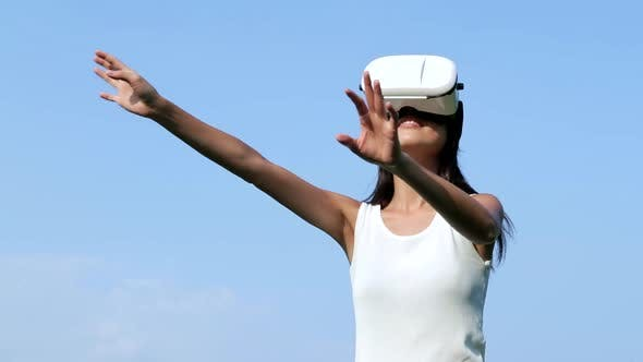 Thumbnail for Woman watching with VR device over blue sky